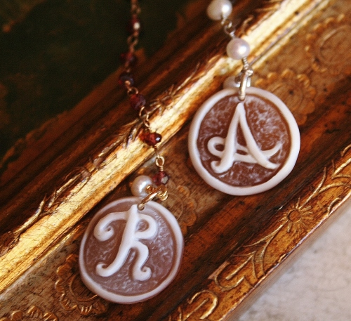 "Cameo with ""A"" and ""R"" letters"