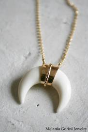 The inverted crescent pendant