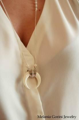 The inverted crescent pendant